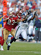 Nov 20, 2005, San Francisco, California, USA;  San Francisco 49er Derrick Johnson(23) tries to break up a pass to Seattle Seahawk receiver Bobby Engram(84) as the Seahawks defeated the 49ers 27-25 at Monster Park.