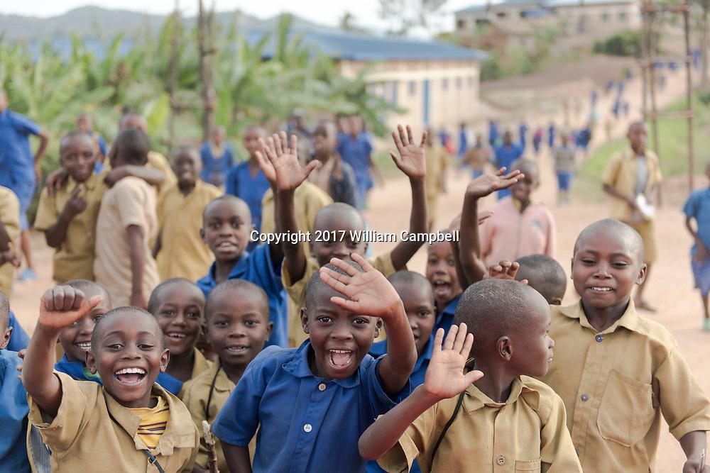 KAYUMBU RWANDA-OCT 11: Primary school children wave after school in the Kyaumbu Sector of Rwanda. In Rwanda 96.5 percent of primary school age children are enrolled in  school. The highest enrollment in Africa. (Photo by William Campbell-Corbis via Getty Images)