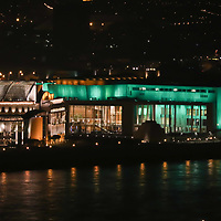 Palace of Art is seen with green light decoration celebrating Saint Patrick's Day in central Budapest, Hungary on March 17, 2017. ATTILA VOLGYI