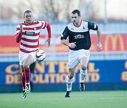 Hamilton's Mickeal Antoine-Curier with Falkirk's David McCracken.<br /> half time : Falkirk 0 v 0 Hamilton, Scottish Championship game at The Falkirk Stadium. © Michael Schofield 2014.