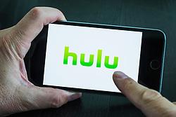Hulu online movie streaming service logo on screen of iPhone 6 Plus smart phone