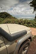 View of a dirty 4x4 safari car at the Ngorongoro Crater viewpoint, Ngorongoro Conservation Area, Tanzania