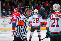 KELOWNA, CANADA - JANUARY 4: Referee, Ward Pateman  stands on the ice between the Spokane Chiefs and the Kelowna Rocketson January 4, 2017 at Prospera Place in Kelowna, British Columbia, Canada.  (Photo by Marissa Baecker/Shoot the Breeze)  *** Local Caption ***