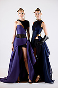 PARIS, FRANCE - JULY 05: Two models show the latest creations of Versace Autumn Winter 2014 fashion show during Paris Haute Couture Fashion Week on July 5, 2014 in Paris, France. (Photo by Lucas Schifres/Getty Images)