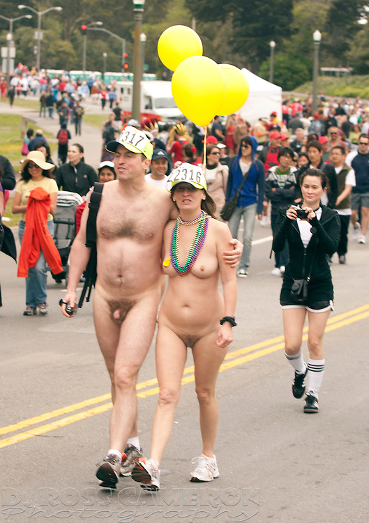 An unidentified naked couple, part of the Bare to Breakers contingent that walks the race in the nude, are photographed from multiple angles as they pass through Golden Gate Park at the 99th running of the Bay to Breakers 12K race, Sunday, May 16, 2010 in San Francisco. (Photo by D. Ross Cameron)