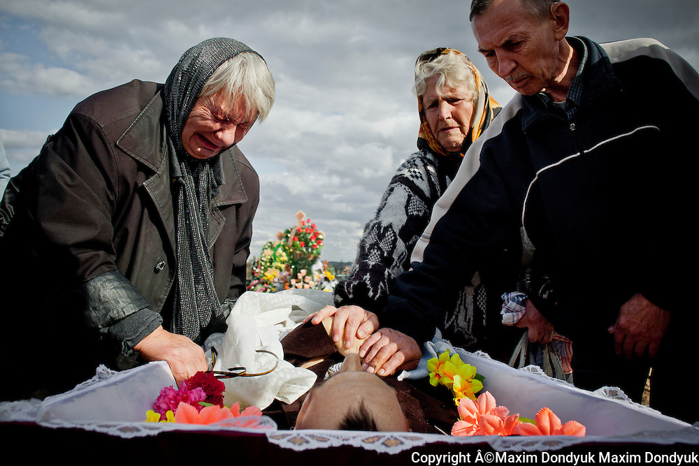 Mother at the funeral of her son...Gennadiy, 42 years old. Diagnosis: multidrug-resistant TB HIV positive. Kherson TB Dispensary, September 14th, 2011..From the words of the patient:.was suffering from tuberculosis for 6 years, didn't have any idea how he became ill. He worked on a fishing vessel in Kamchatka. He returned after receiving a letter from his mother in which she informed that she was dying. Couldn't find a job and began to drink alcohol. He got to the hospital by calling to emergency. Diagnosis: cirrhosis of the liver..From his mother's words:.was selling things from the house and gathering bottles to buy medicine and food for her son, who couldn't rise from the bed over the last few weeks..Died October 12th, 2011. In 1995, the World Health Organization declared the tuberculosis epidemic in Ukraine. Over the past 16 years the situation has greatly worsened. Each day TB takes lives of 30 people, annually - about 10 thousand.
