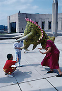 An educator wears a triceratops costume outside the Cincinatti Museum Center.