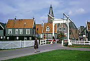 Bascule bridge and traditional village homes and church at Marken, Netherlands, 1973