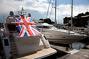 Large Union Jack flag on a boat moored at St Katherine Docks. There has been a big surge in patriotism during the London 2012 Olympics.