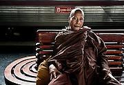 A silent, stern monk waiting for his train. Bangkok, Thailand.