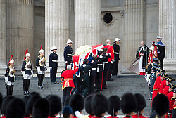 © London News Pictures.17/04/2013. London, UK.  Pallbearers carry the coffin of former British Prime minister Margaret Thatcher as it arrives at St Paul's Cathedral in London for her funeral on April 17, 2013. Photo credit : Ben Cawthra/LNP
