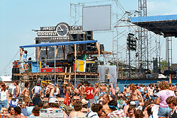The Stage and the Lighting & Sound Booth before the Grateful Dead Concert begins at Roosevelt Stadium on 4 August 1976. Candace Brightman can be seen tweaking her magic at her lights board in the booth.