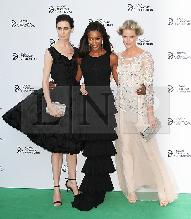 © Licensed to London News Pictures. Erin O'Connor,  Naomi Campbell and Caroline Winberg at the Novak Djokovic Foundation London gala dinner, The Roundhouse, London UK, 08 July 2013. Photo credit: Richard Goldschmidt/LNP