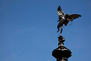 Famous statue of Eros at Piccadilly, London. Piccadilly Circus is a famous road junction and public space of London's West End in the City of Westminster, built in 1819 to connect Regent Street with the major shopping street of Piccadilly.