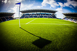 The flag at the half-way line casts a shadow on the new plastic pitch, laid at The Falkirk Stadium, for the Scottish Championship game v Hamilton. The woven GreenFields MX synthetic turf and the surface has been specifically designed for football with 50mm tufts compared with the longer 65mm which has been used for mixed football and rugby uses.  It is fully FFA two star compliant and conforms to rules laid out by the SPL and SFL.<br /> ©Michael Schofield.