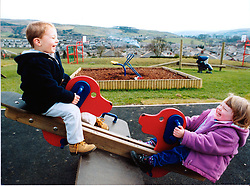 Small children playing on seesaw in North Yorkshire