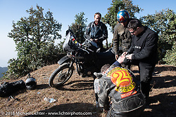 Chris Shelby took one of the first spills (most of us took one, and I took four!) of the trip on day-2 of our Himalayan Heroes adventure riding from Daman to Chitwan, Nepal. Sean Lichter, Round the World Doug Wothke and Kelly Modlin attend to the wounds. Wednesday, November 7, 2018. Photography ©2018 Michael Lichter.
