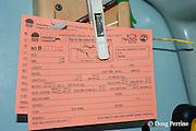 tagging cards aboard Reel Addiction, Vava'u, Kingdom of Tonga, South Pacific