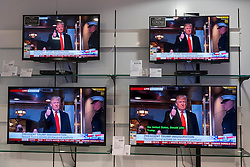 © Licensed to London News Pictures. 20/01/2017. London, UK. Multiple TV screens in a department store show the live broadcast of the inauguration of Donald Trump as U.S. President. Photo credit : Stephen Chung/LNP