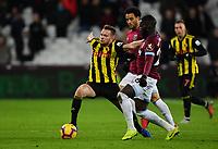 Football - 2018 / 2019 Premier League - West Ham United vs. Watford <br /> <br /> Watford's Tom Cleverley battles with West Ham United's Arthur Masuaku, at The London Stadium.<br /> <br /> COLORSPORT/ASHLEY WESTERN