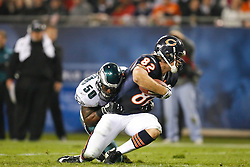 Philadelphia Eagles linebacker Will Witherspoon #50 tackles Chicago Bears tight end Greg Olsen #82 during the NFL game between the Philadelphia Eagles and the Chicago Bears on November 22nd 2009. The Eagles won 24-20 at Soldier Field in Chicago, Illinois. (Photo By Brian Garfinkel)