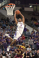 Kansas State guard Lance Harris (3) flies over Bethune-Cookman guard Antonio Webb (2) in the second half, during K-State's 74-61 win over Buthune-Cookman at Bramlage Coliseum in Manhattan, Kansas, December 17, 2005.