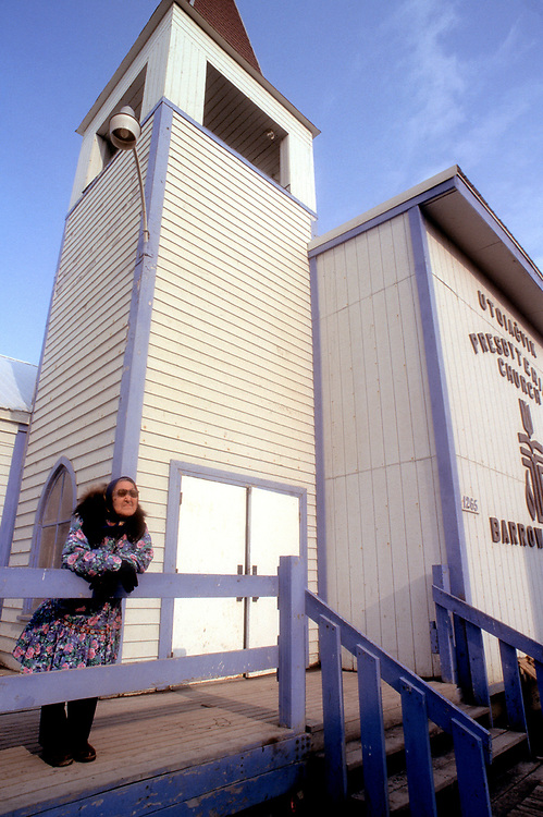 Amy Okpeaha stands outside the Presbiterian Church while waiting for the service in Iñupiaq to begin. The church is over a hundred years-old.<br /> <br /> May 18, 19:22