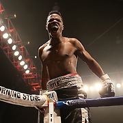 """Simeon Hardy celebrates after knocking out Rahman Yusubov in the first round of the undercard match during the ESPN """"Boxcino"""" boxing tournament at Turning Stone Resort Casino on Friday, April 18, 2014 in Verona, New York.  (AP Photo/Alex Menendez)"""