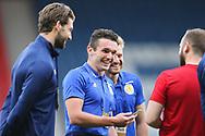 John McGinn of Scotland shares a joke with teammates ahead of the International Friendly match between Scotland and Belgium at Hampden Park, Glasgow, United Kingdom on 7 September 2018.