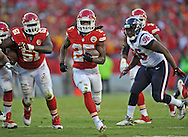 KANSAS CITY, MO - OCTOBER 20:  Running back Jamaal Charles #25 of the Kansas City Chiefs rushes past defensive end Tim Jamison #96 of the Houston Texans for a first down during the second half on October 20, 2013 at Arrowhead Stadium in Kansas City, Missouri.  Kansas City won 17-16. (Photo by Peter Aiken/Getty Images) *** Local Caption *** Jamaal Charles;Tim Jamison