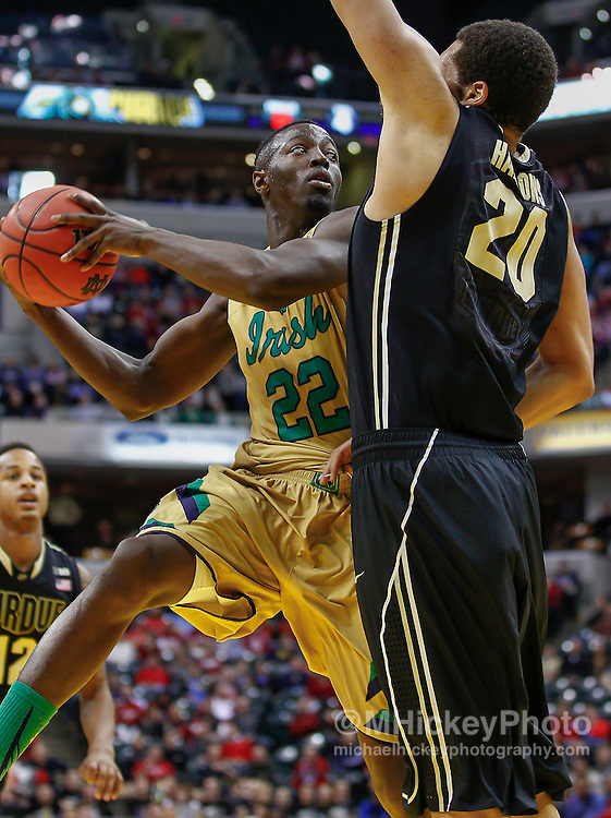 INDIANAPOLIS, IN - DECEMBER  20: Jerian Grant #22 of the Notre Dame Fighting Irish looks for a teammate to pass the ball to as A.J. Hammons #20 of the Purdue Boilermakers defends at Bankers Life Fieldhouse on December 20, 2014 in Indianapolis, Indiana. Notre Dame defeated Purdue 94-63. (Photo by Michael Hickey/Getty Images) *** Local Caption *** Jerian Grant; A.J. Hammons