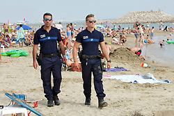 Armed national and municipal police forces as well as military officers patrol the beaches in La Grande Motte, southern France on August 4, 2016. Photo by Pascal Parrot/ABACAPRESS.COM