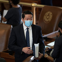 Austin, TX USA March 31, 2021:  State Rep. Gene Wu, D-Houston, on the floor of the Texas House of Representatives during routine bill readings at the 87th Texas legislative session. Emergency bills include power company regulation, border security and the coronavirus response.