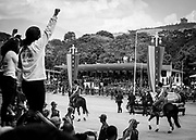 """People salute the car that transports the coffin of Venezuela's President Hugo Chávez, during the parade on Los Proceres boulevard in Caracas on the 15th March 2013. The coffin of Venezuela's President, Hugo Chávez, was translated from the Military Academy to the 4th February Military heaquarters where it will stay until a final decision is made for the final place of his remains. Chávez ruled Venezuela for 14 years, passed away on the 5th March 2013.  He revolutionized not only his nation but also other countries in Latin America, with his political views and what he called the """"21st Century Socialism"""", supported by the petrodollars from Venezuela's massive oil-reserves."""
