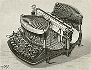 The Williams typewriter:  machine with QWERTY keyboard, travelling carriage and letters printing at a central point.   Engraving, 1893.