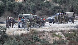 20.10.2015, Hebron, PSE, Gewalt zwischen Palästinensern und Israelis, im Bild Ausschreitungen, Demostrationen und Zusammenstösse zwischen Palästinensischen Demonstranten und Israelischen Sicherheitskräfte // Israeli security forces inspect the scene, where is a Palestinian man stabbed an Israeli soldiers, in the West Bank village of Beit Awwa near Hebron on October 20, 2015. Triggered by Israeli incursions into the Al-Aqsa Mosque compound last month, violence and protests against Israel's occupation have increased in frequency across the West Bank, including East Jerusalem, and the Gaza Stri, Palestine on 2015/10/20. EXPA Pictures © 2015, PhotoCredit: EXPA/ APAimages/ Muhesen Amren<br /> <br /> *****ATTENTION - for AUT, GER, SUI, ITA, POL, CRO, SRB only*****