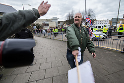 © Licensed to London News Pictures . 30/01/2016 . Dover , UK . A far right protester uses a placard to assault a photographer . Demonstrations by far-right groups (including The National Front , The North West Infidels and The South East Alliance ) and , opposing them , anti-fascists , close to the port of Dover in Kent . Photo credit : Joel Goodman/LNP