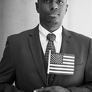 """""""I honestly don't like the candidates, but I have to choose one to lead, and with the experience and circle Hillary has, I'd rather go that way,"""" explained John Dixon, 35, a Jamaican born immigrant who, having just received his citizenship at a Los Angeles ceremony moments earlier, registered with the Democratic Party."""