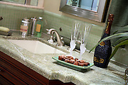 Bathroom Sink And Faucet With Green Granite Countertops