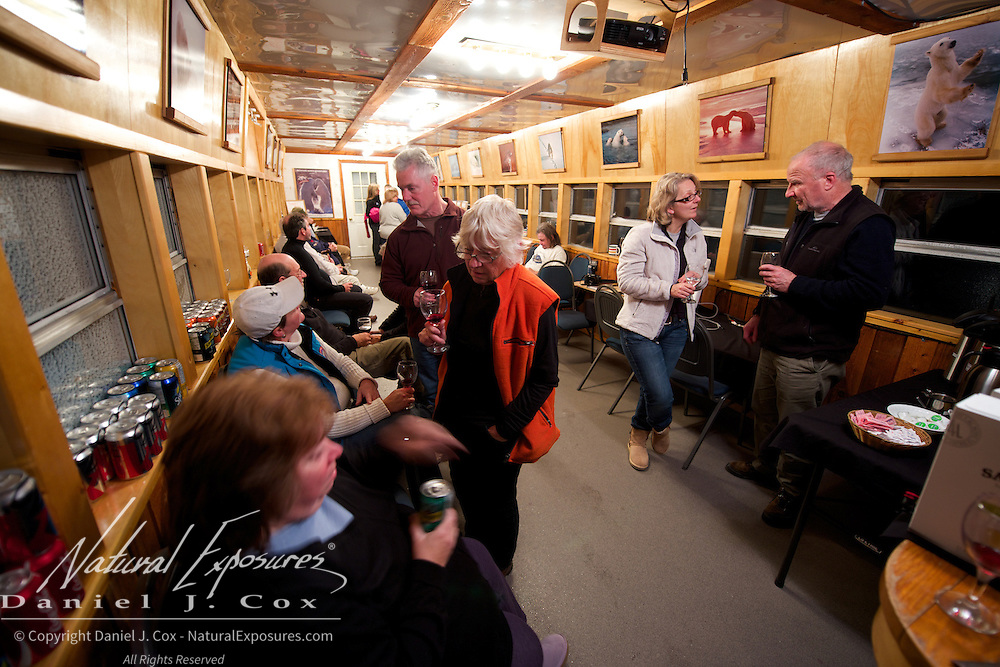 Guests enjoying the end of the day in the Tundra Buggy Lounge at Cape Churchill, 2012