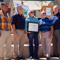Mayor Jackie McKinney, center, receives a plaque from the the Wyland Foundation Tuesday morning at the McKinley County Courthouse Square to celebrate Gallup being one of the top five cities in the Wyland National Mayor's Challenge for Water Conservation.