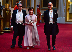 DUP deputy leader Nigel Dodds and wife Diane with Governor of the Bank of England Mark Carney arrive at the State Banquet at Buckingham Palace, London, on day one of US President Donald Trump's three day state visit to the UK.