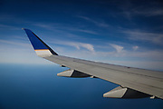 SHOT 10/19/17 9:49:33 AM - The wing of a United Airlines plane during a flight to Buffalo, N.Y. looking out over Lake Michigan. Buffalo, N.Y. is the second most populous city in the state of New York and is located in Western New York on the eastern shores of Lake Erie and at the head of the Niagara River. By 1900, Buffalo was the 8th largest city in the country, and went on to become a major railroad hub, the largest grain-milling center in the country and the home of the largest steel-making operation in the world. The latter part of the 20th Century saw a reversal of fortunes: by the year 1990 the city had fallen back below its 1900 population levels. (Photo by Marc Piscotty / © 2017)