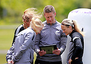 Head coach Tony Readings looks over footage with hois players. Football Ferns Media and Training Session, QBE Stadium Auckland, Wednesday 12th November 2014. Photo: Shane Wenzlick