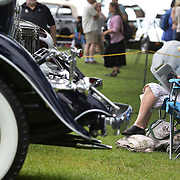 A lady relaxes by a 1931 Cadillac 355A at the Greenwich Concours d'Elegance Festival of Speed and Style featuring great classic vintage cars. Roger Sherman Baldwin Park, Greenwich, Connecticut, USA.  2nd June 2012. Photo Tim Clayton
