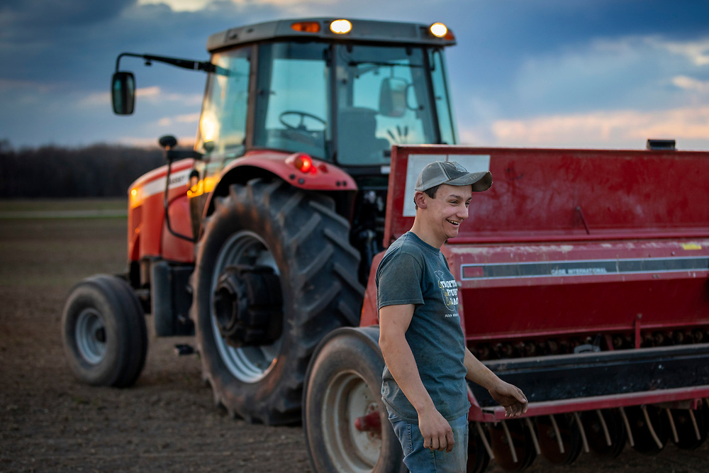 Jeremy Schiless smiles as he takes a break from spring planting at Old Settler's Dairy