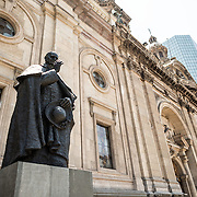 A statue of Chilean cardinal Jose Maria Caro Rodriguez (1866-1958) in Plaza de Armas in front of the Metropolitan Cathedral of Santiago, Chile.