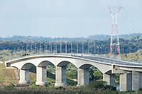 The concrete bridge spanning the Zambezi River at Caia and with electric pylons in the background, Caia, Zambezi River Floodplain, Sofala Province, Mozambique