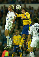 Photo. Jed Wee<br /> Leeds United v Southampton, FA Barclaycard Premiership, Elland Road, Leeds. 26/08/2003.<br /> Leeds' Alan Smith (L) and Southampton's Claus Lundekvam challenge for possession.