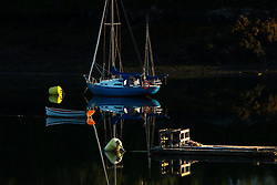 The last light of the day reflects the boats and moorings in a quiet cove. This image received an Honorable mention in the 2019 International Color Awards.